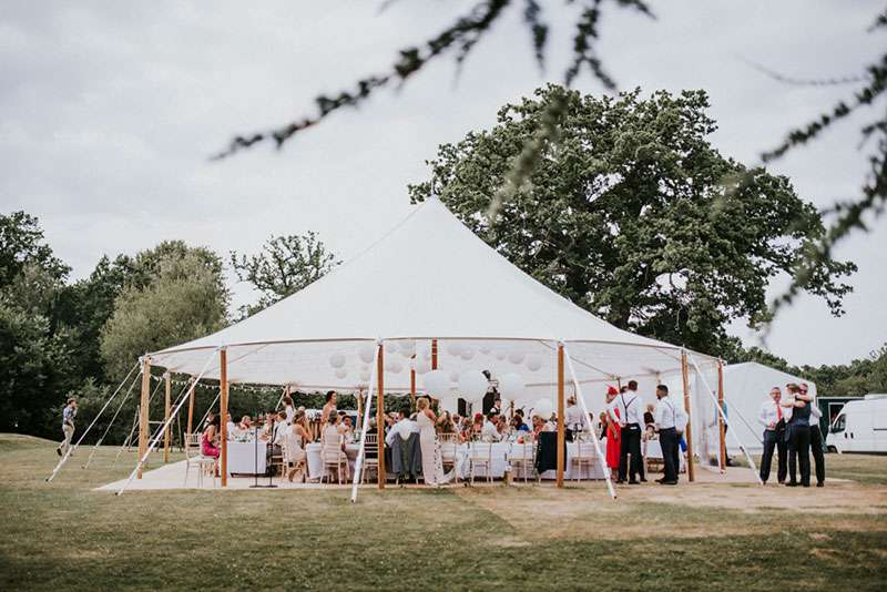 Sailcloth Tent Behind Tree Branch