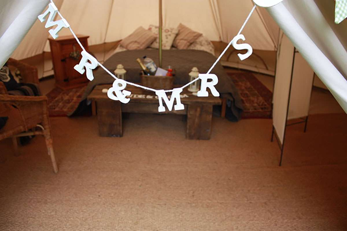 mr & mrs text hanging in glamping tent entrance