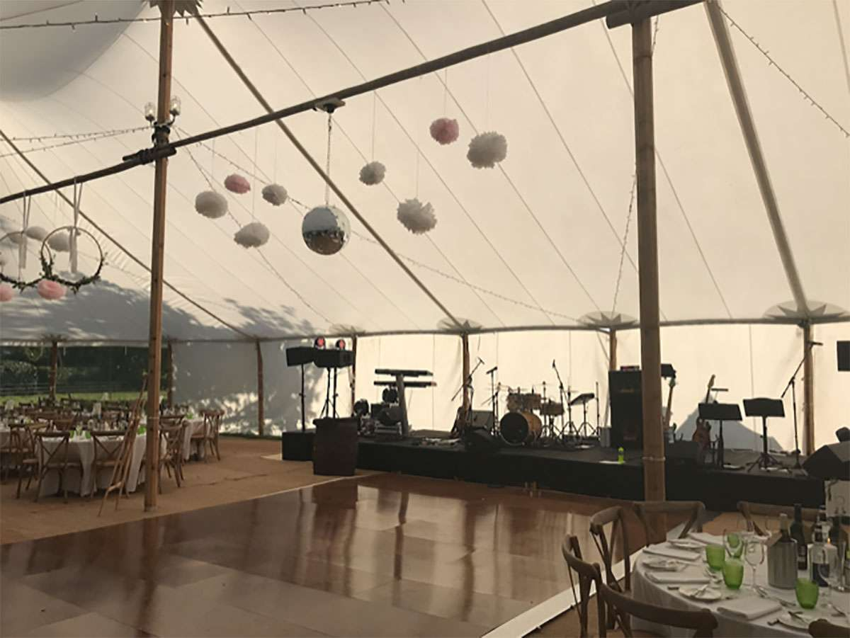 decorations in sailcloth tent with dance floor underneath