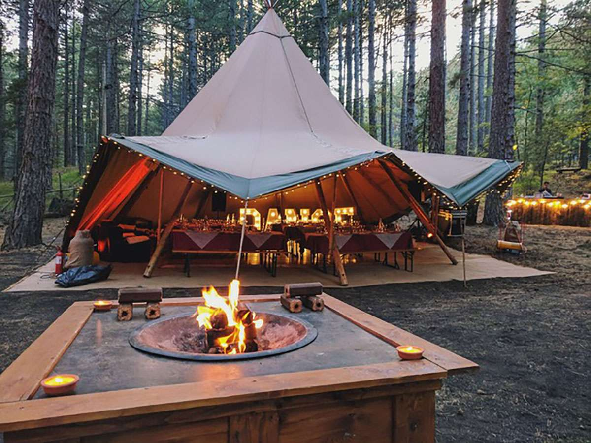 Tipi & fire pit in the woods