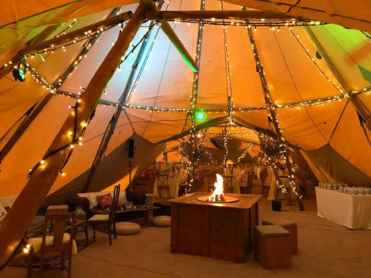 Fire pit inside tipi chill out area