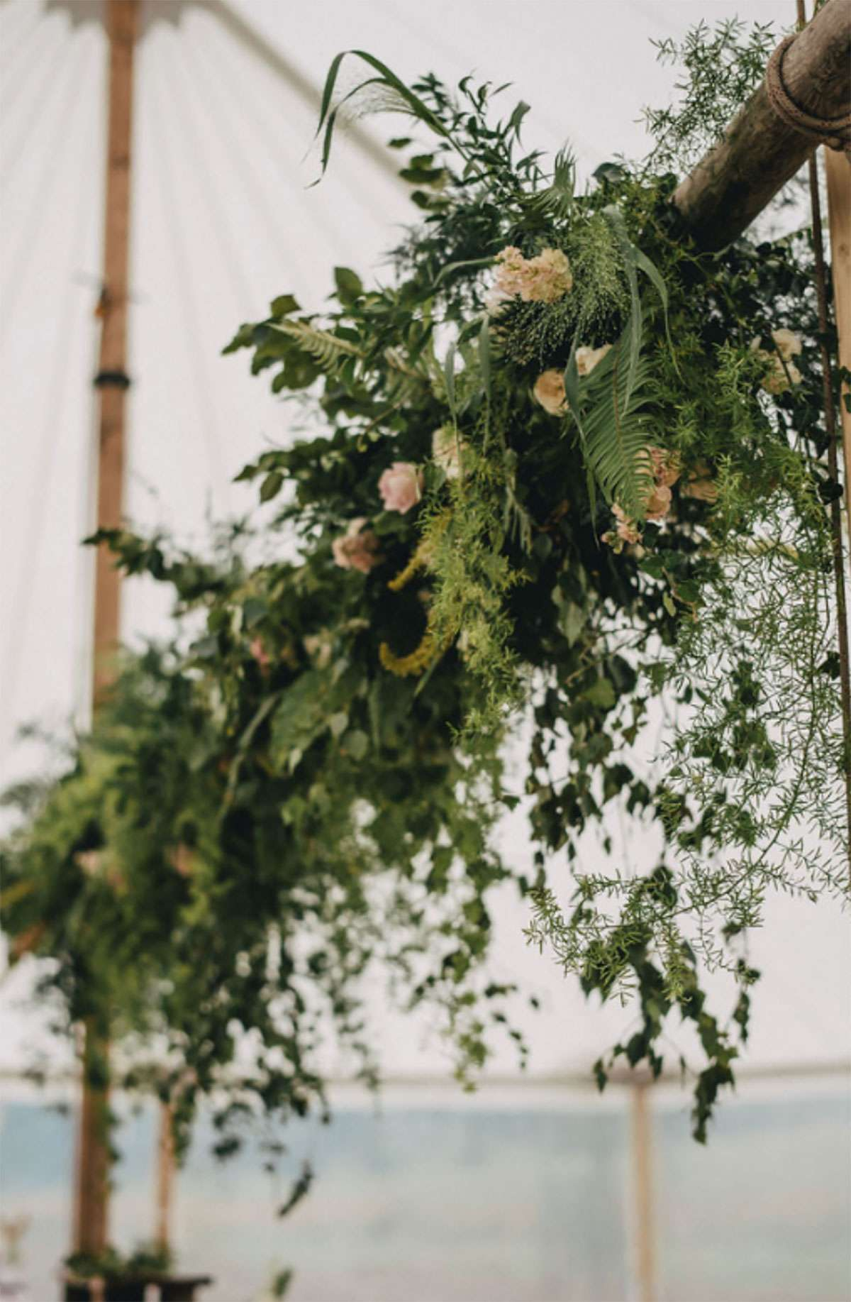 floral pole in sailcloth tent