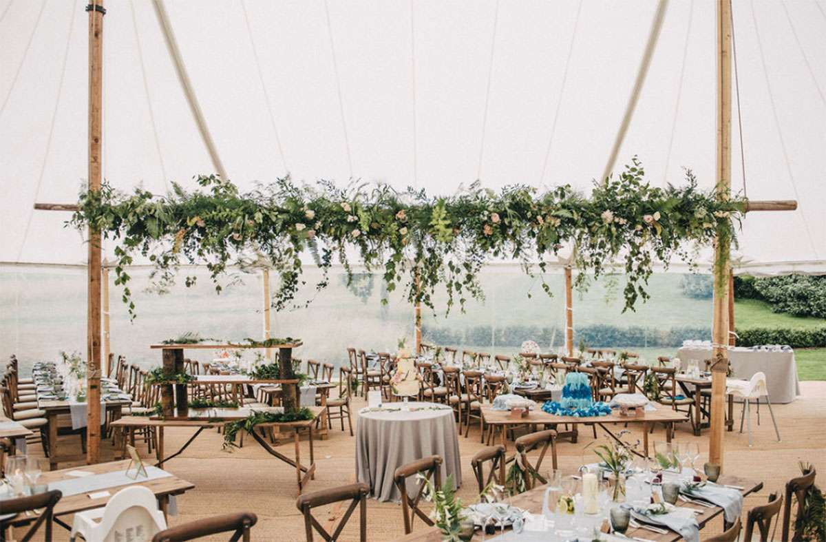 floral pole in sailcloth wedding tent