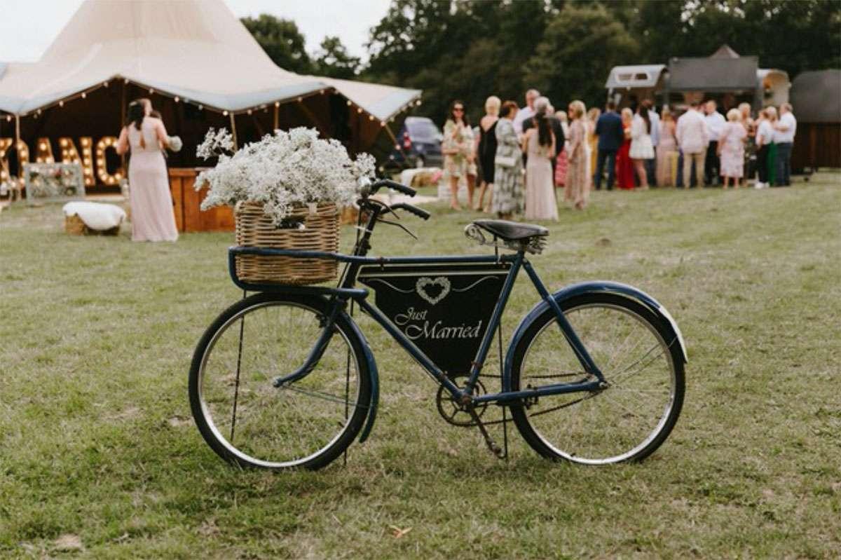 just married bike on field outside tipi