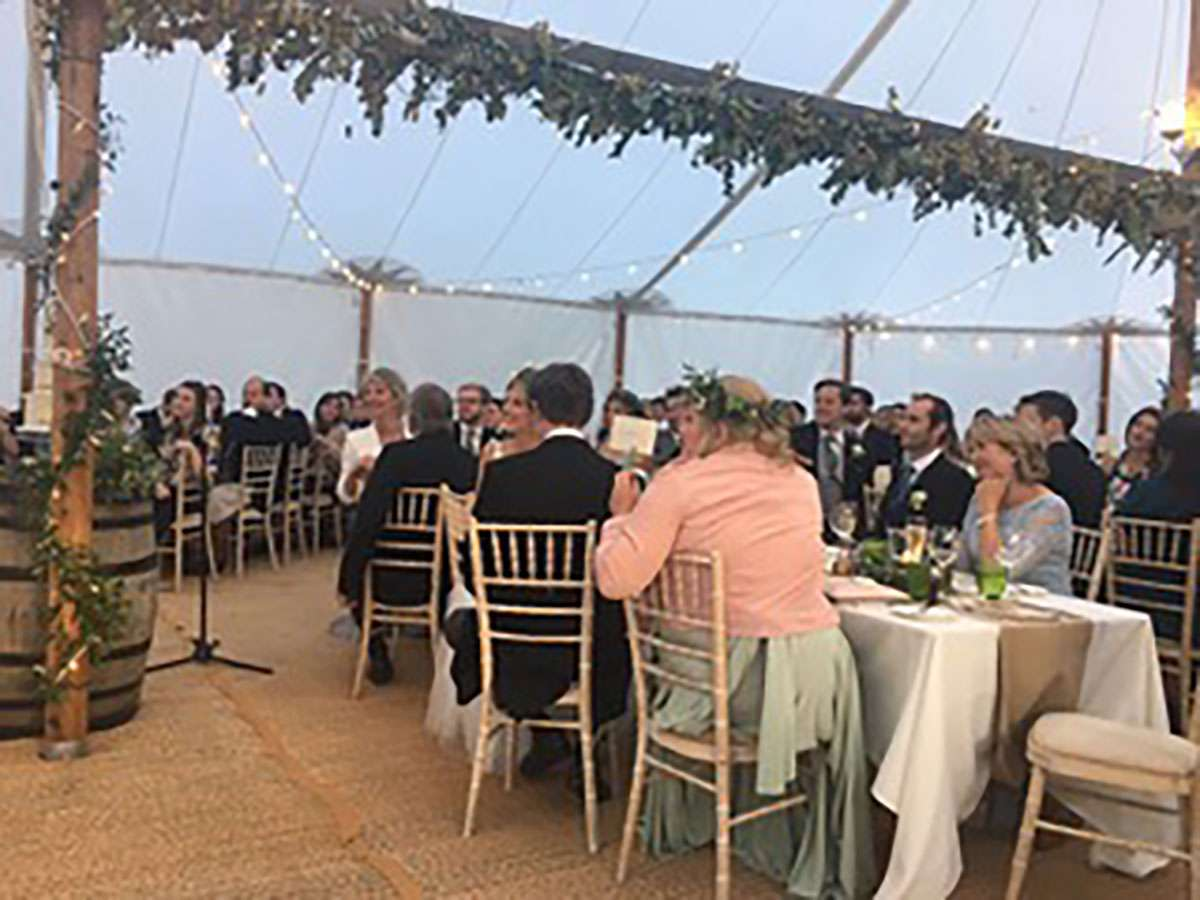 floral ladder in sailcloth tent with audience