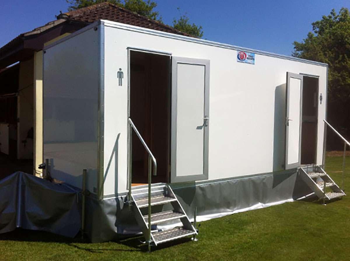 luxury toilets on grass with door open