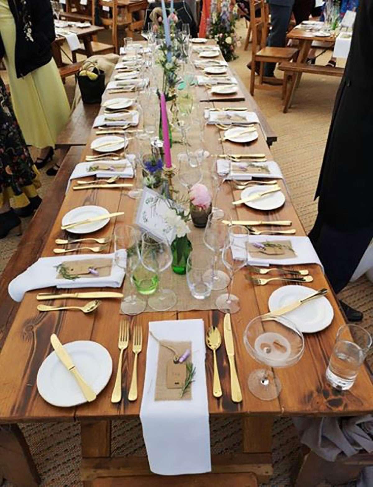 long table with setup for wedding meal