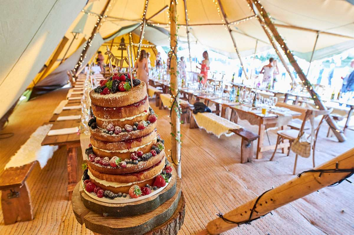 wedding cake on table in tipi