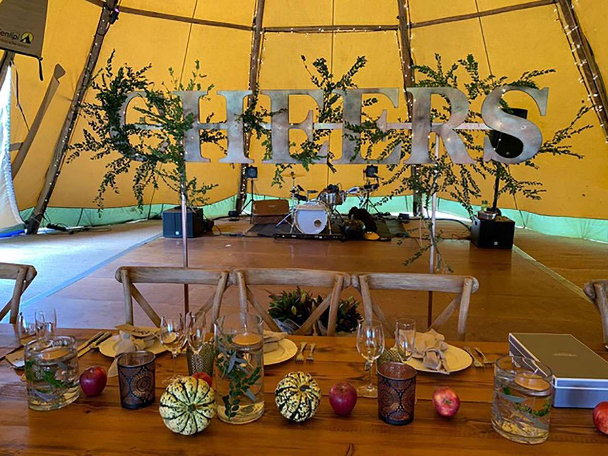 top table in tipi with letters