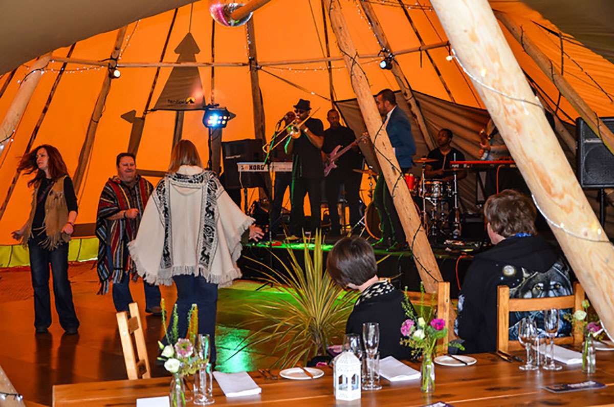 Stage inside tipi with band performing