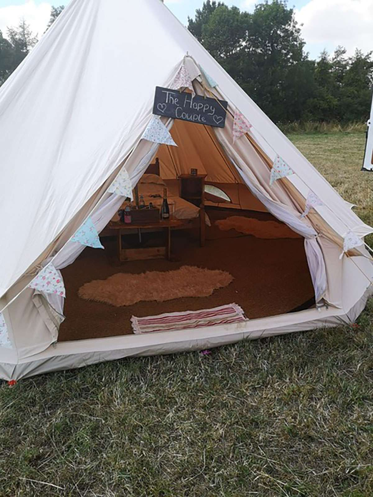 glamping tent with bed on grass