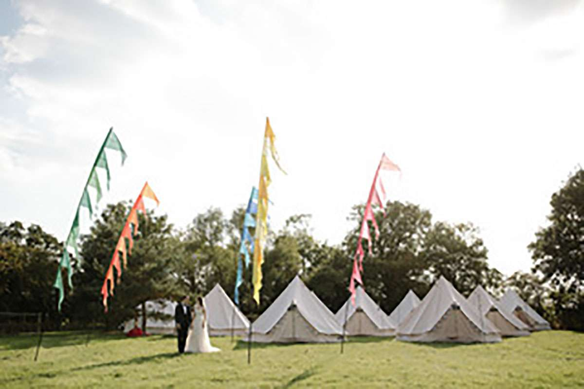 glamping tents with flags