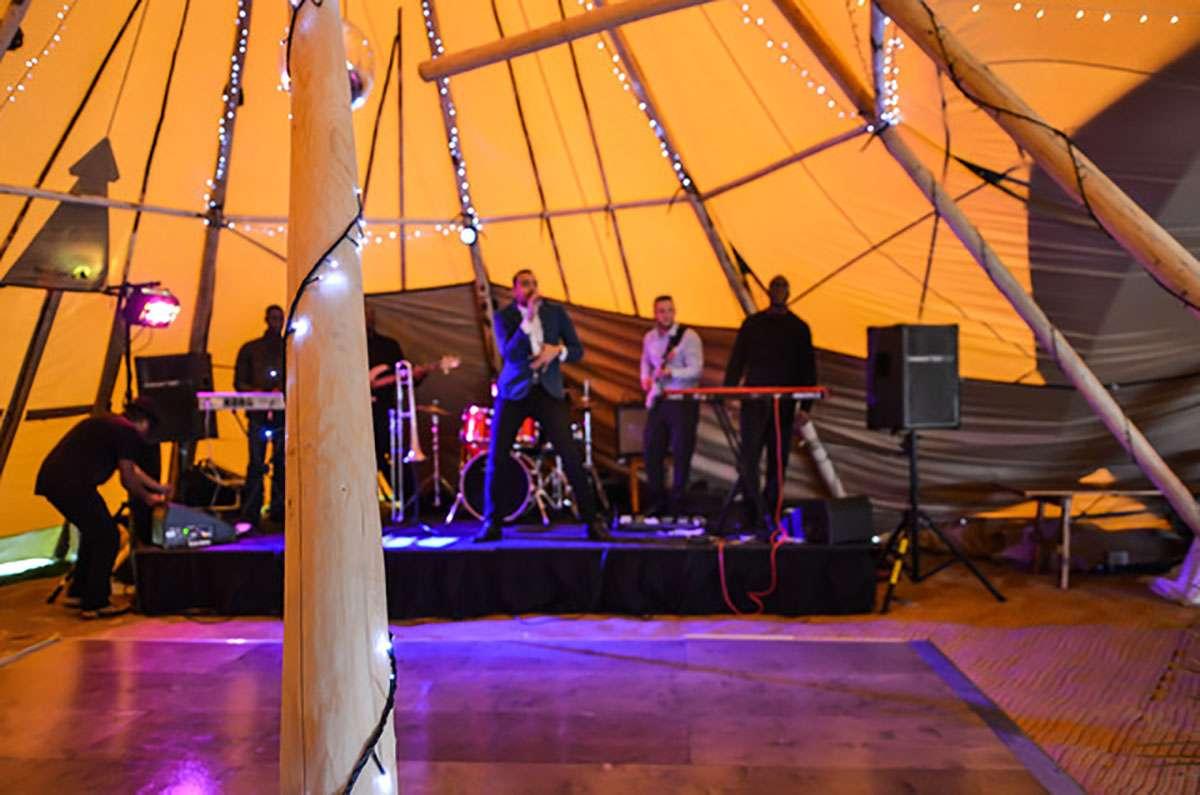 Ashton jones performing on stage in tipi