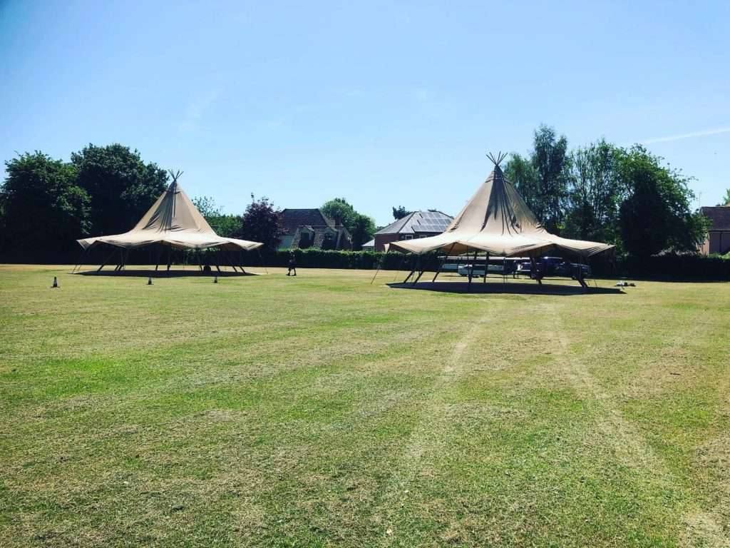 Tipi tents on field