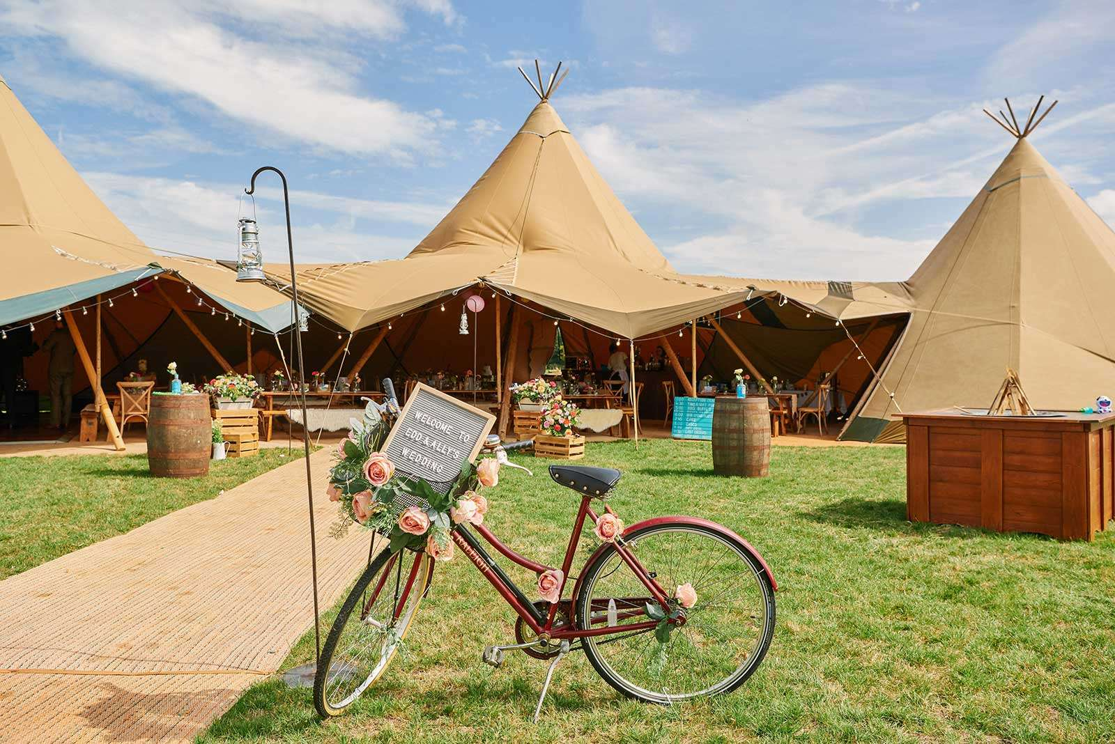 Linked tipis with bicycle