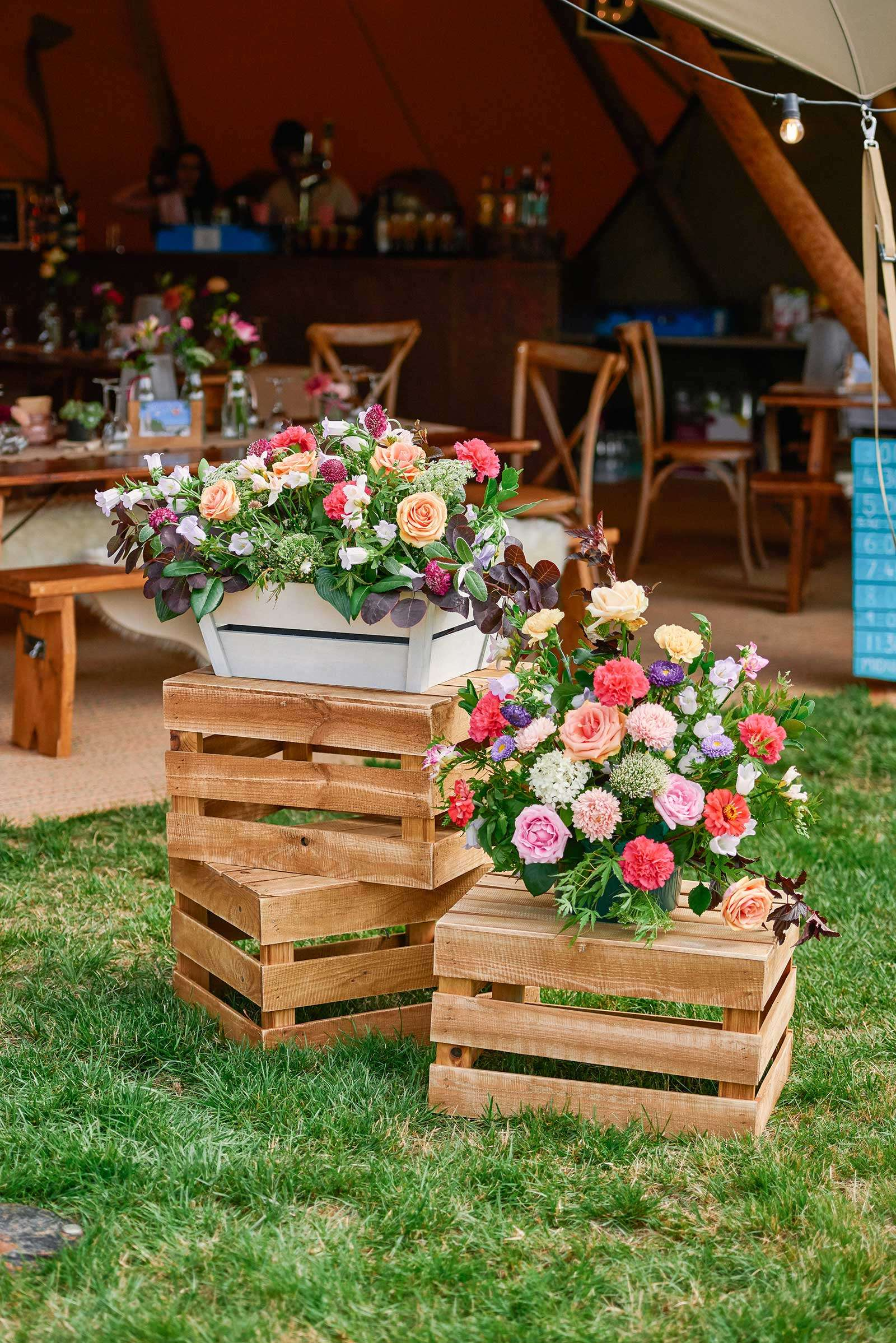 flowers on crates outside tipi