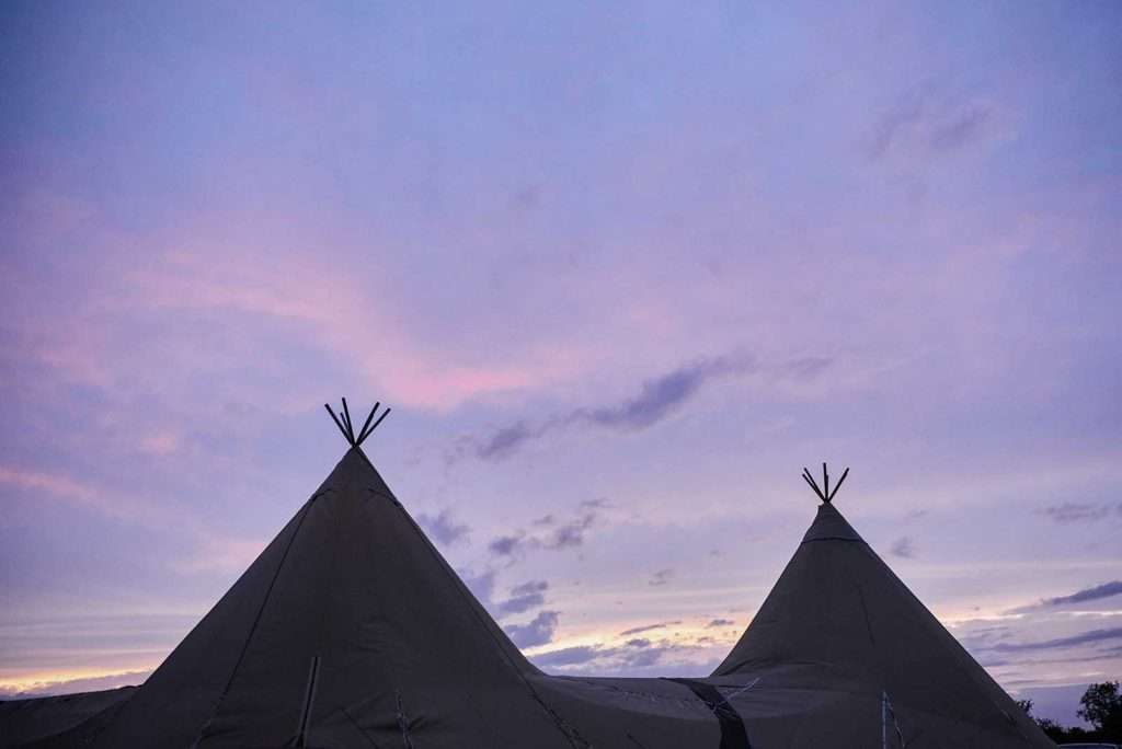 sunset over tipi tents